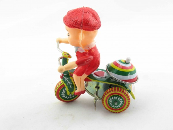 Blechspielzeug - Junge auf Dreirad