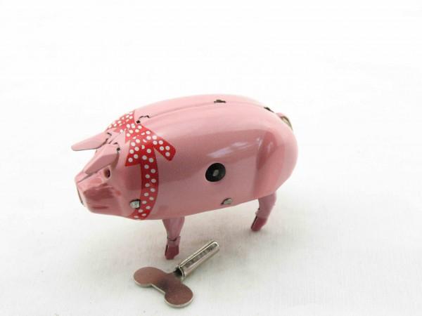 Blechspielzeug - Schwein Polly mit roter Schleife